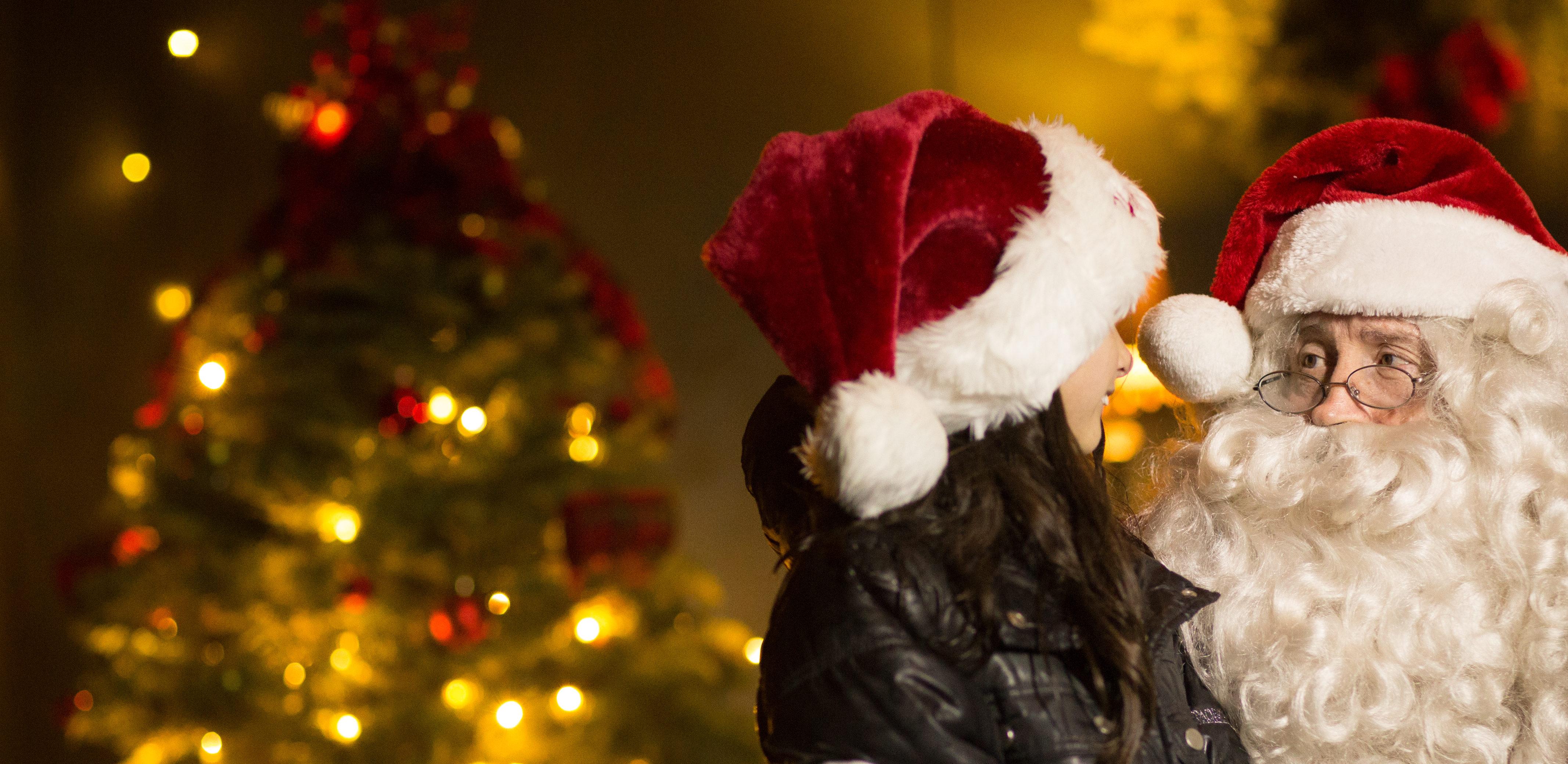 kid with santa holiday